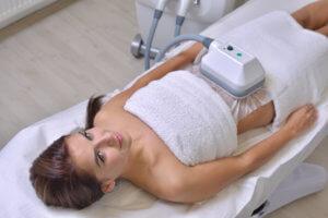image of a lady having fat freezing treatment